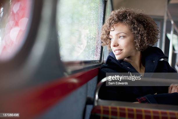 Smiling woman riding bus