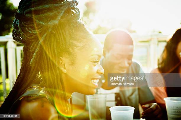 Smiling woman sharing a meal friends outdoors