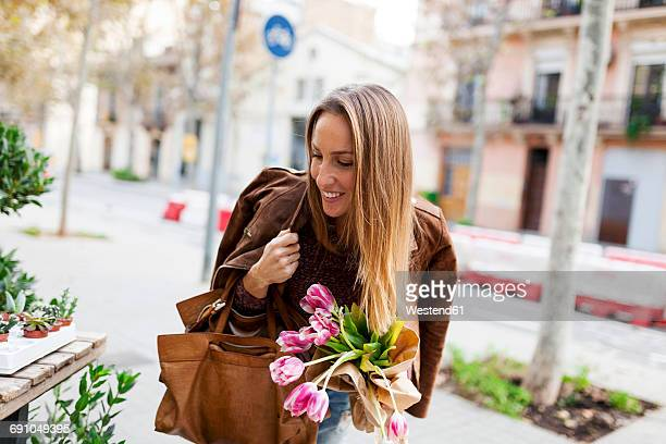 Smiling woman shopping for flowers
