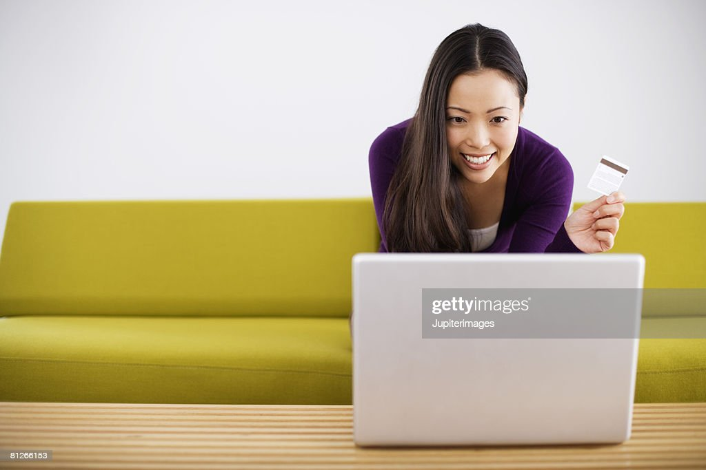 Smiling woman shopping online : Stock Photo