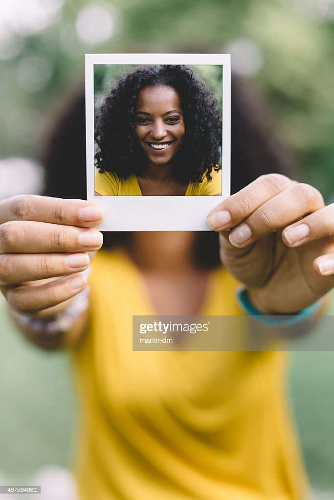 Smiling woman showing selfie : Stock Photo