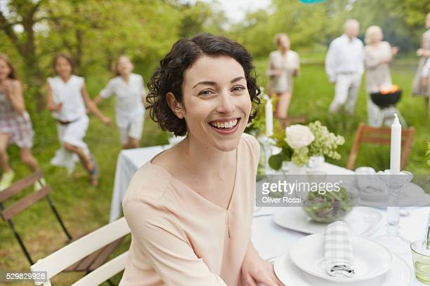 Smiling woman sitting at outdoor table