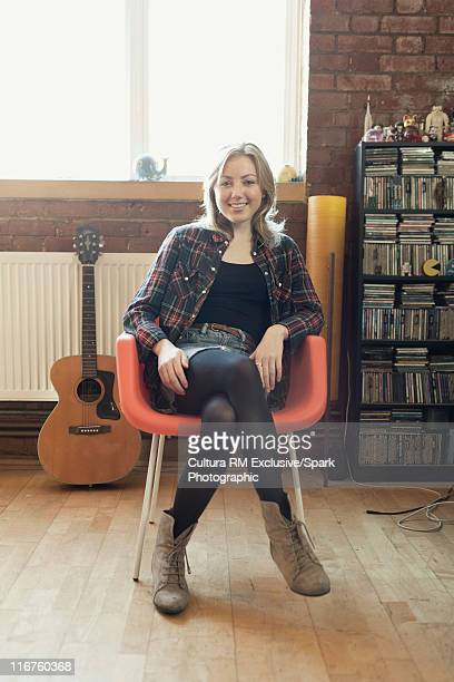 Smiling woman sitting in modern chair