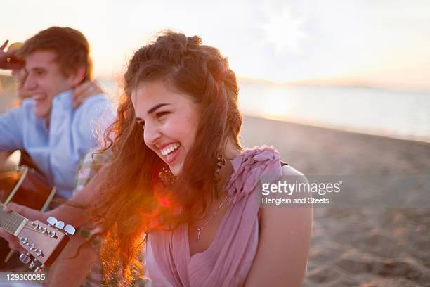 Smiling woman sitting on beach