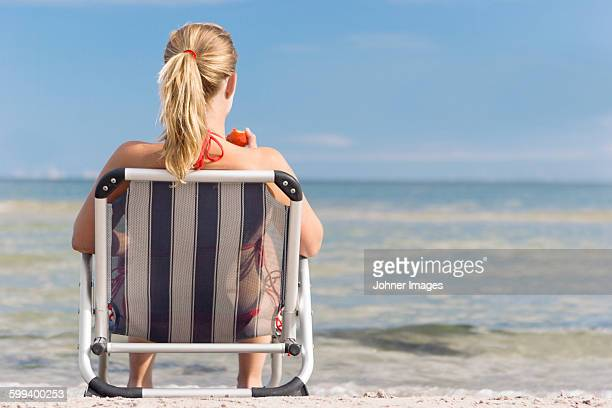 Smiling woman sitting on beach