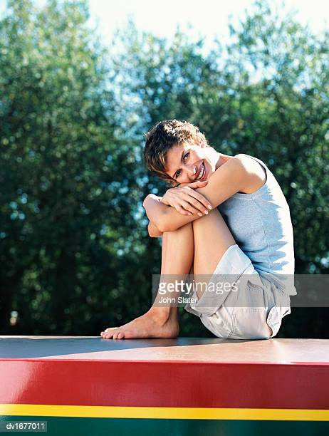 Smiling Woman Sitting on the Roof of a Boat
