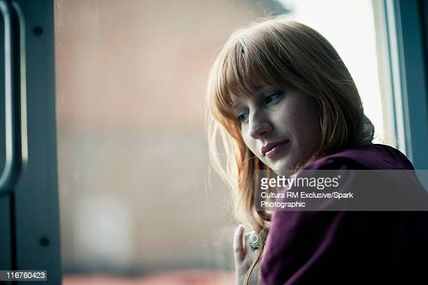 Smiling woman standing by window