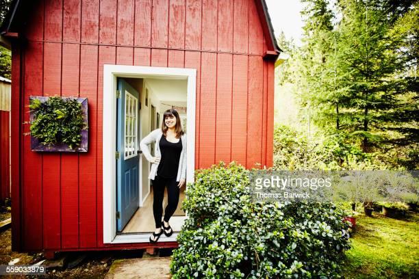 Smiling woman standing in doorway of office