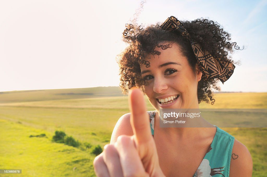 Smiling woman standing in meadow : Stock Photo