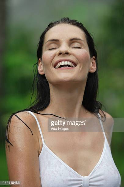 smiling woman standing in rain