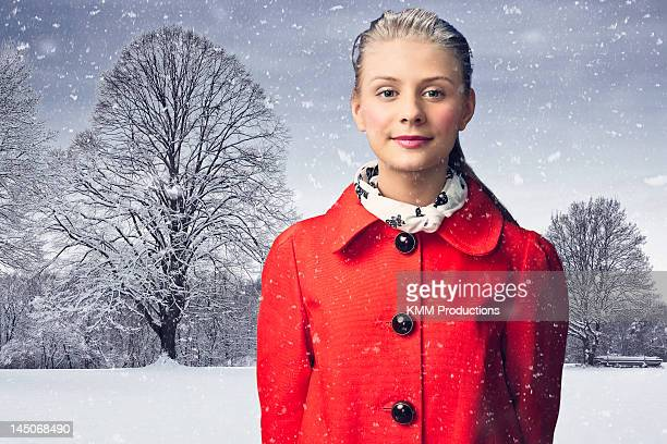 Smiling woman standing in snow