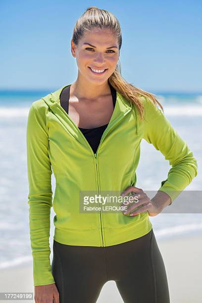 Smiling woman standing on the beach