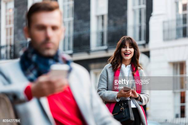 smiling woman standing outdoors on the city street - bloomsbury london stock photos and pictures