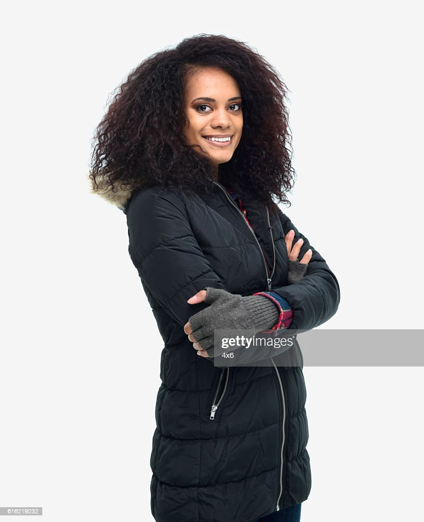 Smiling woman standing with arms crossed : Stock Photo