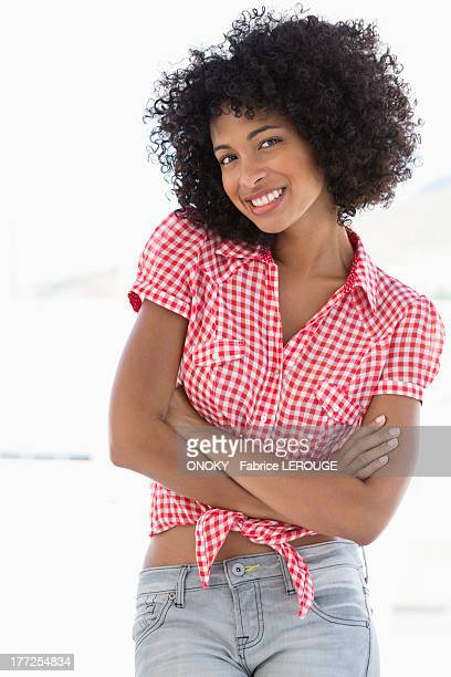 Smiling woman standing with her arms crossed