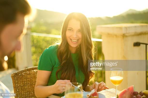 smiling woman sunrise breakfast