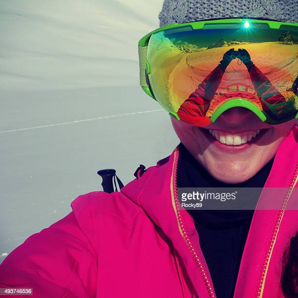 Smiling woman taking a selfie in the snow