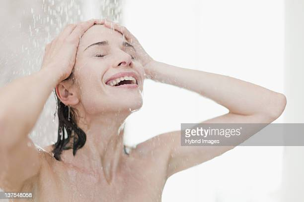Smiling woman taking shower