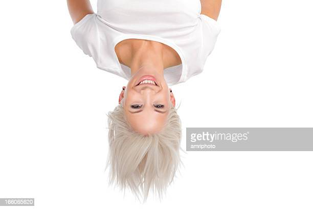 smiling woman upside down - upside down stock pictures, royalty-free photos & images