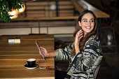 side view smiling woman drinking coffee