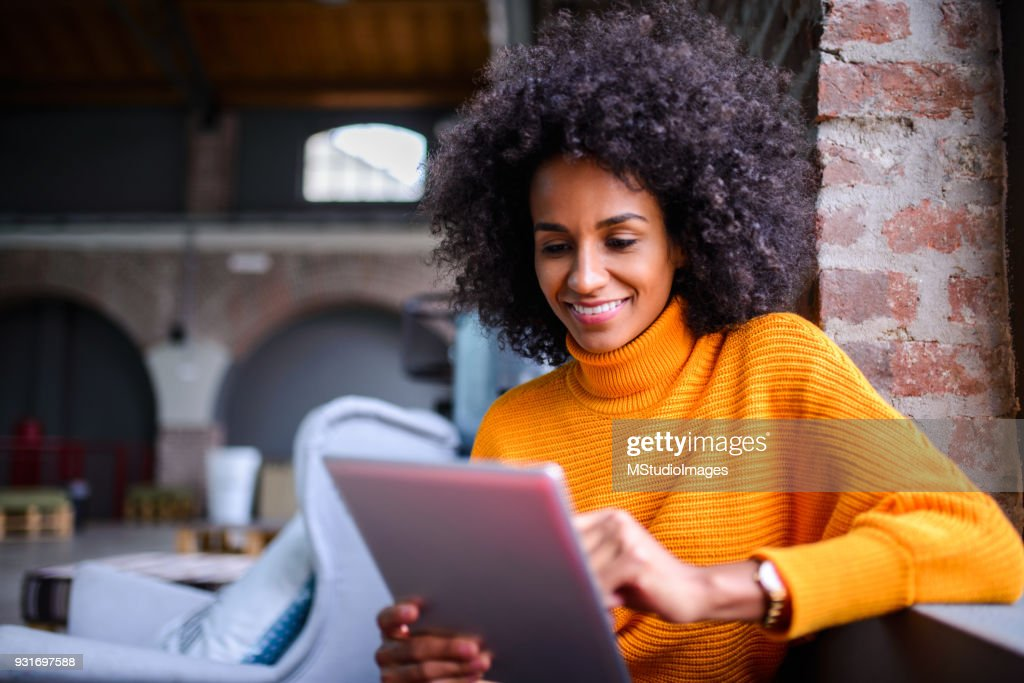 Smiling woman using digital tablet. : Stock Photo