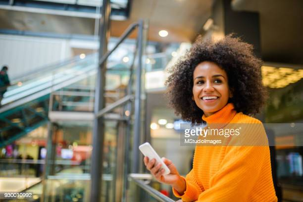 smiling woman using mobile phone. - science and technology stock pictures, royalty-free photos & images