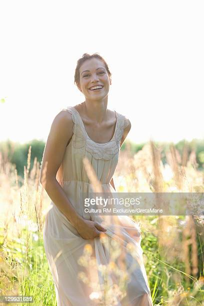 Smiling woman walking in wheatfield
