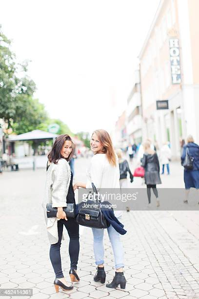 smiling woman walking together, vaxjo, smaland, sweden - vaxjo stock pictures, royalty-free photos & images