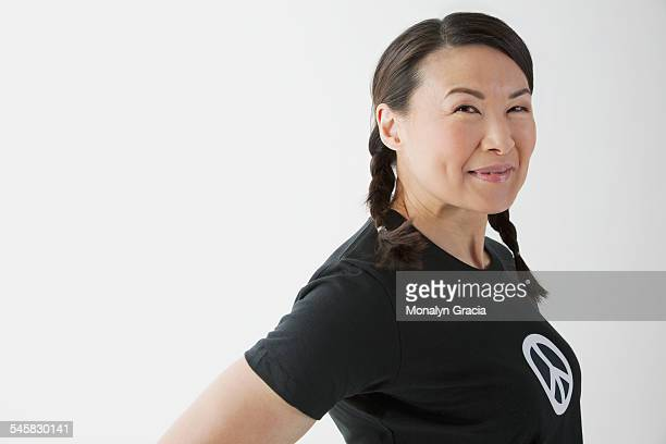 Smiling woman wearing a peace t-shirt