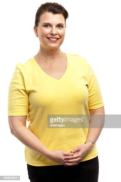 A smiling woman wearing a yellow t-shirt