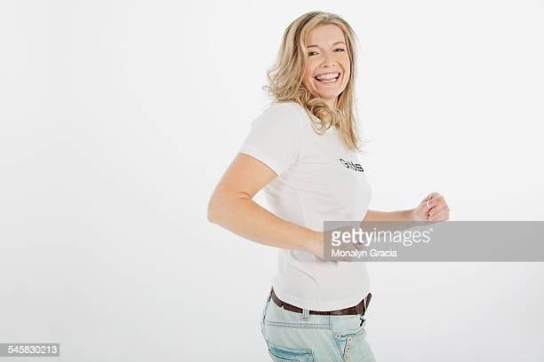 Smiling woman wearing goddess t-shirt