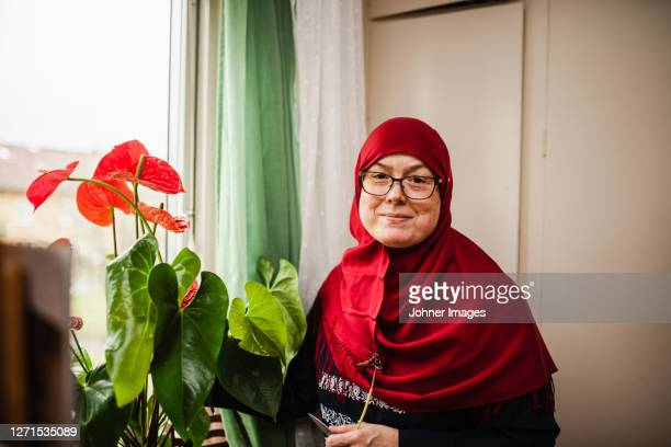 smiling woman wearing hijab - västra götaland county stock pictures, royalty-free photos & images