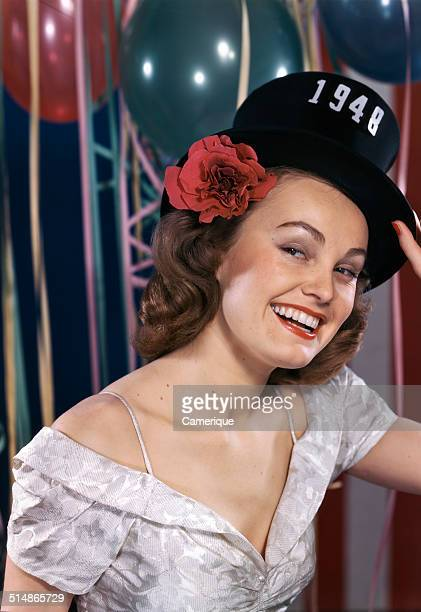 Smiling woman wearing new years eve party hat of 1948 Los Angeles California 1949