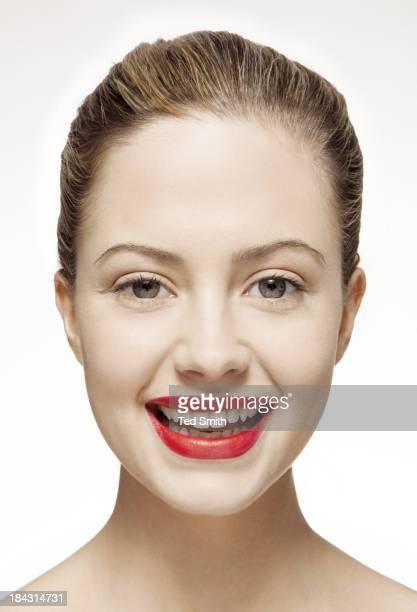 Smiling woman wearing red lipstick