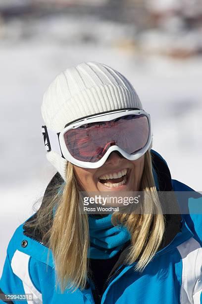 Smiling woman wearing ski goggles
