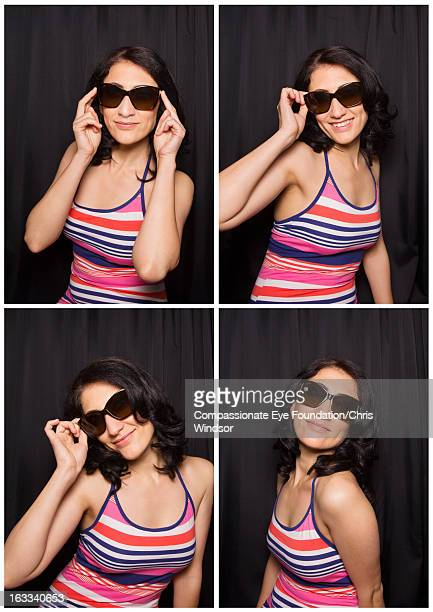 """smiling woman wearing sunglasses in photo booth - """"compassionate eye"""" stock pictures, royalty-free photos & images"""