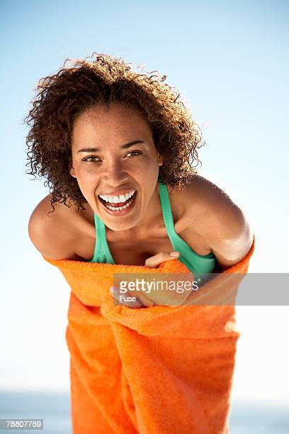 smiling woman wearing towel - 30 39 years stock pictures, royalty-free photos & images