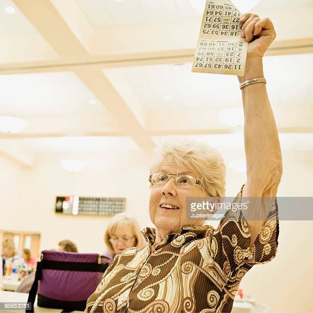 Smiling woman winning bingo