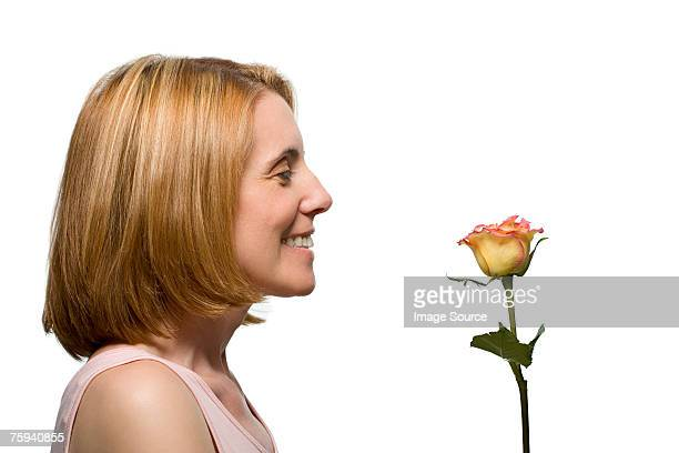 Smiling woman with a rose
