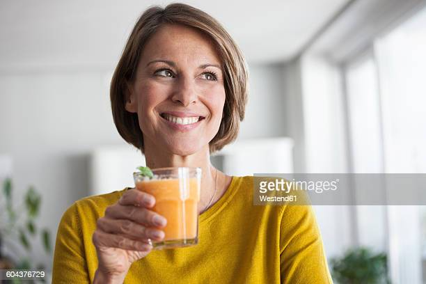 Smiling woman with a smoothie