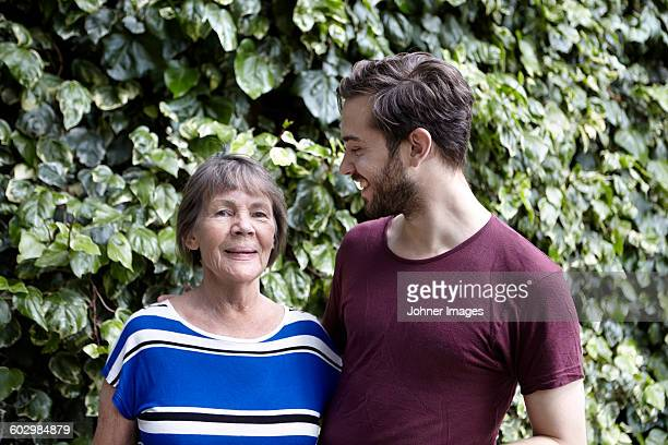 smiling woman with adult son - mother and son stock photos and pictures