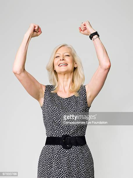 smiling woman with arms up in the air - cef do not delete stock pictures, royalty-free photos & images