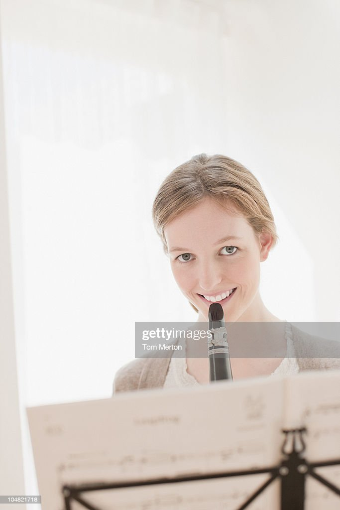 Smiling woman with clarinet : Stock Photo