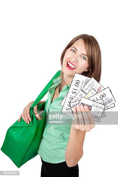 smiling woman with coupons and grocery bag - coupon stock pictures, royalty-free photos & images