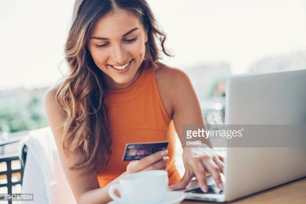smiling woman with credit card and laptop - online shopping stock photos and pictures
