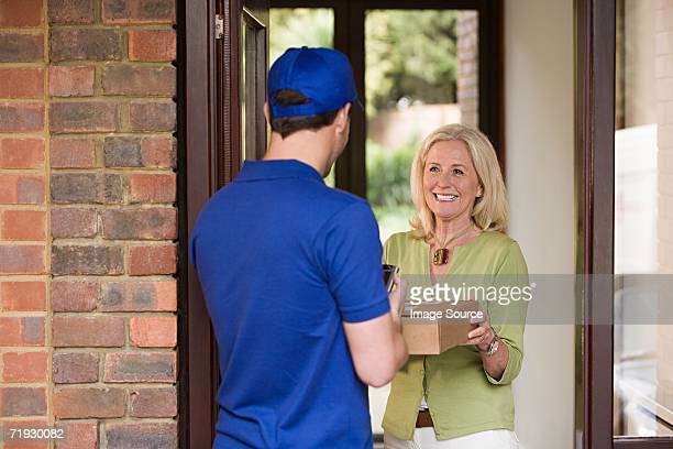 Smiling woman with delivery man