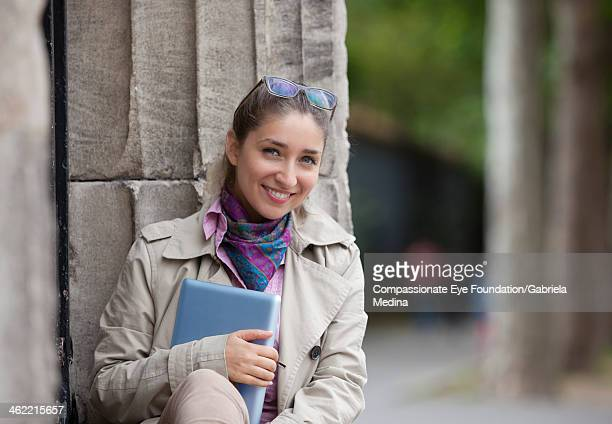 """smiling woman with digital tablet outdoors - """"compassionate eye"""" stock pictures, royalty-free photos & images"""