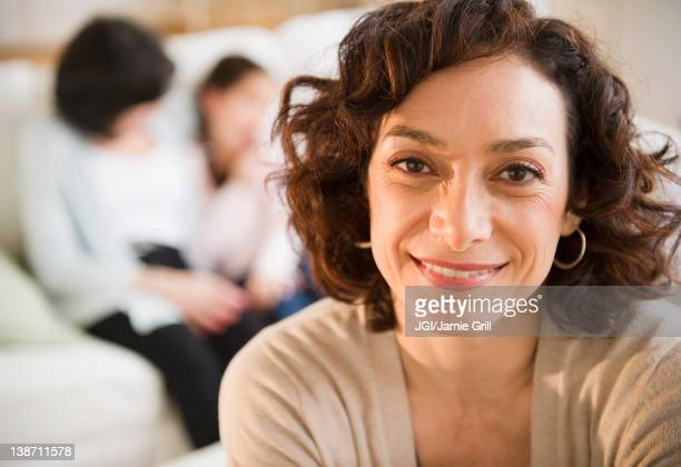Smiling woman with family in background