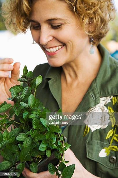 Smiling woman with fresh mint