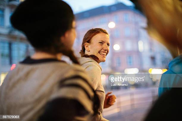 smiling woman with friends jogging on street - foco diferencial imagens e fotografias de stock